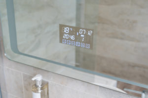 close up of touchscreen bathroom mirror