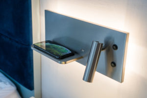 phone shelf next to bed with usb ports
