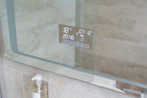 close up of touch screen bathroom mirror